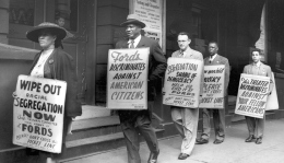 HEN.00.A2-156 Picket line. Protesting Jim Crow admission policy at Ford's Theatre, Baltimore. Paul Robeson pictured second from left. NAACP Baltimore Branch protest signs. March, 1948 Paul S. Henderson (1899-1966) 4 x 5 inch black and white negative
